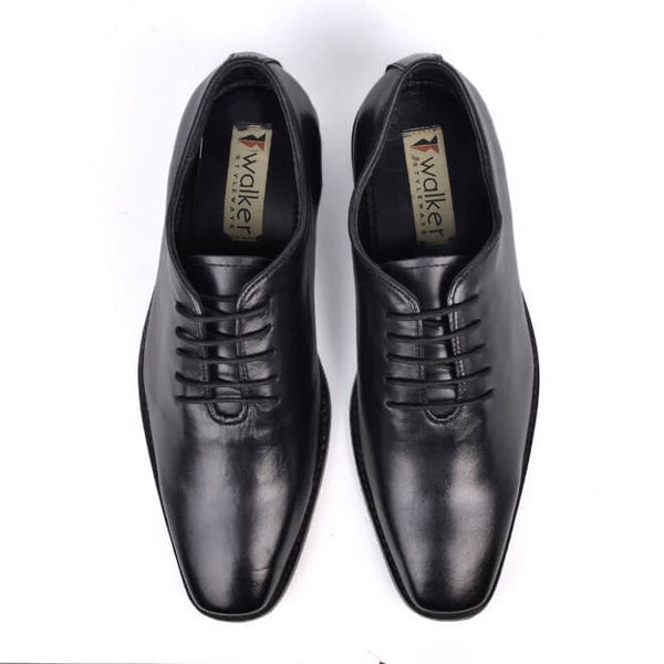 A top view of men's whole cut xxw shoes made in black leather