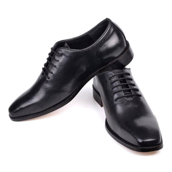 A side view of men's whole cut xxw shoes made in black leather