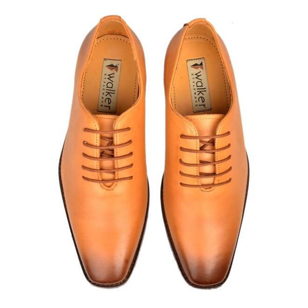 A top view of men's whole cut xxw shoes made with tan leather