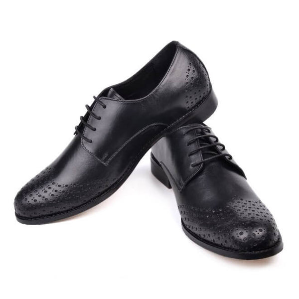 A side view of size 38 men's derby brogue shoes made with black leather