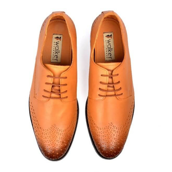 A top view of size 38 men's derby brogue shoes made with tan leather