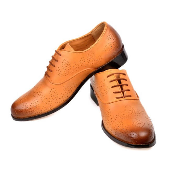 A side view of men's oxford brogue xxw width shoes made with tan leather