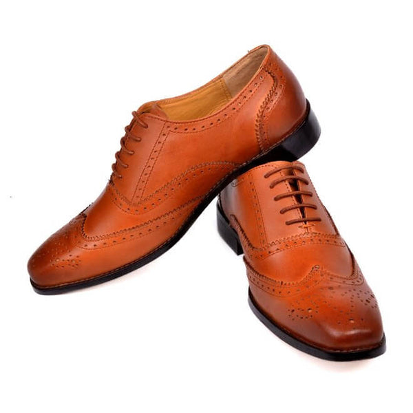 A side view of oxford brogues shoes for broad feet made in dark tan leather