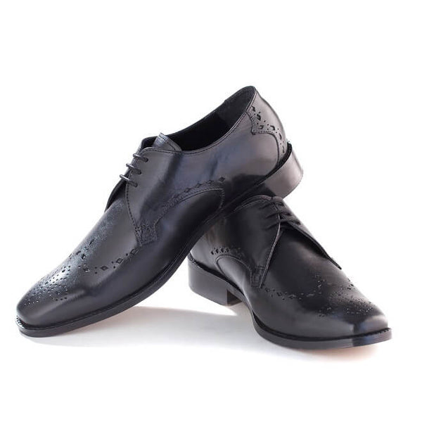 A side view of pair of men's custom made derby brogue shoes made with black leather