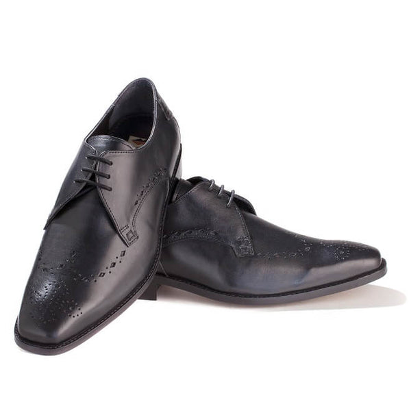 A top view of pair of men's custom made derby brogue shoes made with black leather