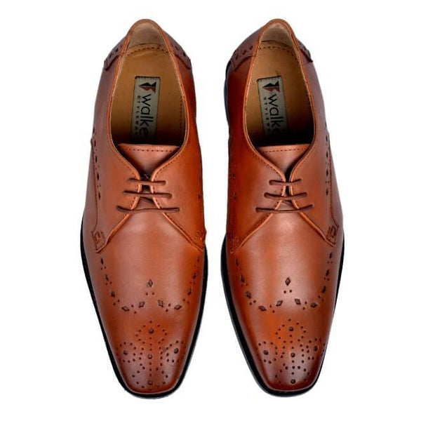 A top view of pair of men's custom made derby brogue shoes made with cognac leather