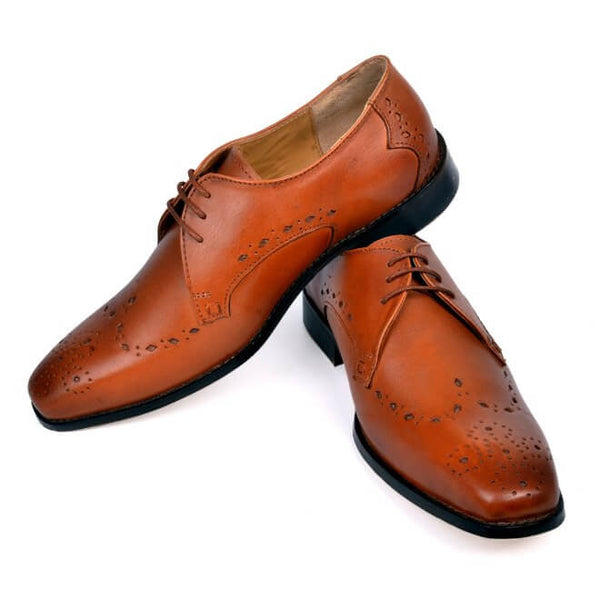 A side view of pair of men's custom made derby brogue shoes made with cognac leather