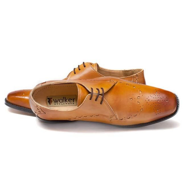 A top view of men's custom made derby brogue shoes made with tan leather