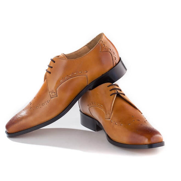 A side view of pair of men's custom made derby brogue shoes made with tan leather