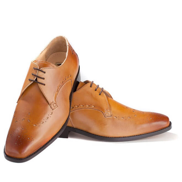 A top view of pair of men's custom made derby brogue shoes made with tan leather