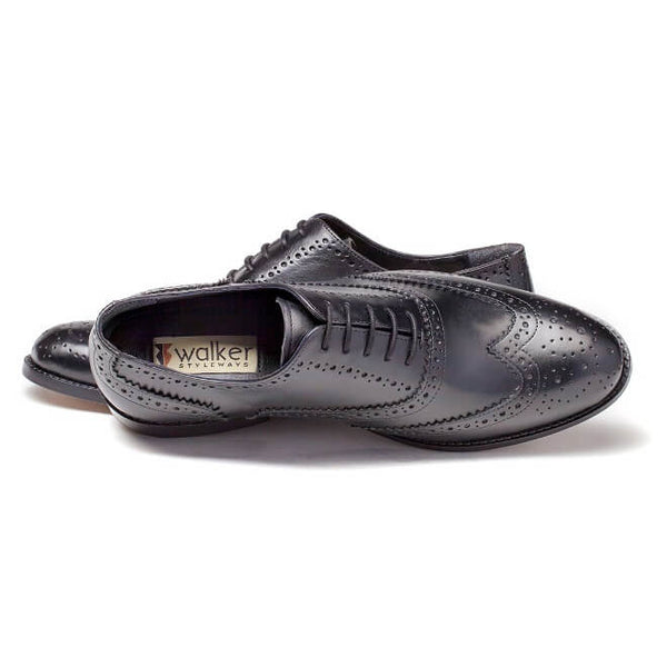 A top view of men's handmade wingtip oxford brogue shoes made with black leather