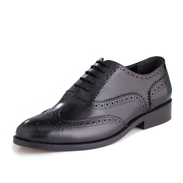 A side view of men's handmade wingtip oxford brogue shoes made with black leather