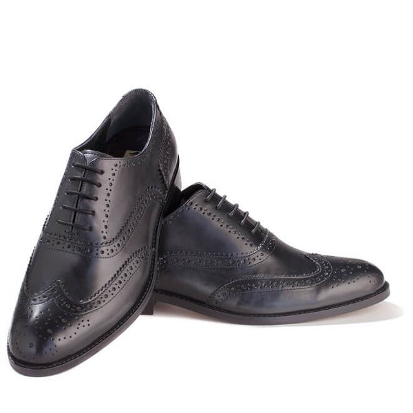 A front view of pair of men's handmade wingtip oxford brogue shoes made with black leather