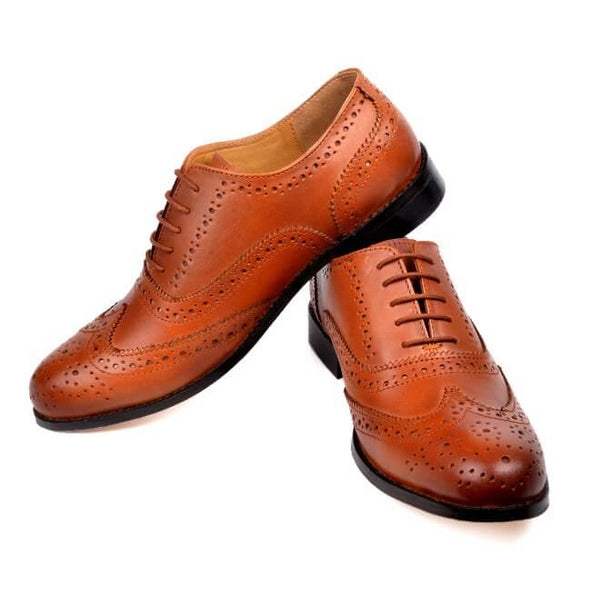 A side and front view of men's handmade wingtip oxford brogue shoes made with cognac leather