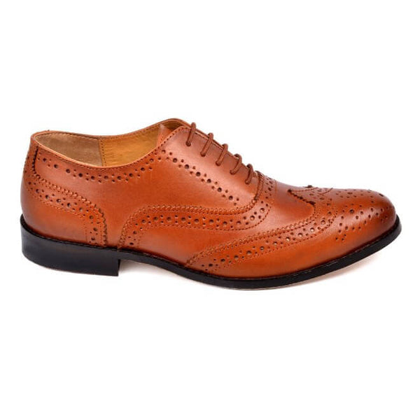 A side view of men's handmade wingtip oxford brogue shoes made with cognac leather