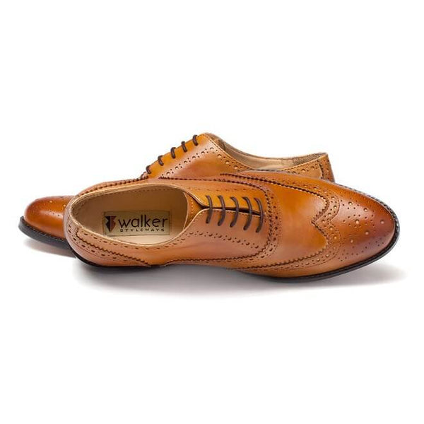 A top view of men's handmade wingtip oxford brogue shoes made with tan leather