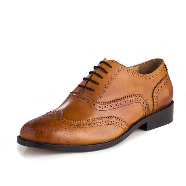 A side view of men's handmade wingtip oxford brogue shoes made with tan leather