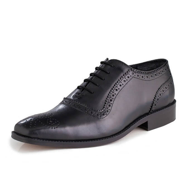 A side view of men's handcrafted oxford brogue shoes made with black leather