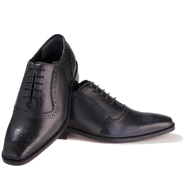 A top view of men's handcrafted oxford brogue shoes made with black leather