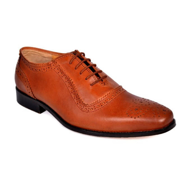 A side view of men's handcrafted oxford brogue shoes made with cognac leather