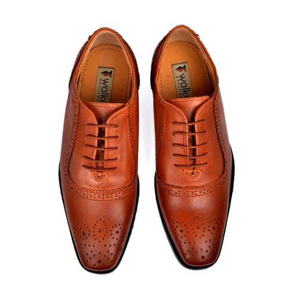 A top view of men's handcrafted oxford brogue shoes made with cognac leather