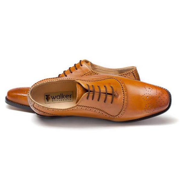 A top view of men's handcrafted oxford brogue shoes made with tan leather