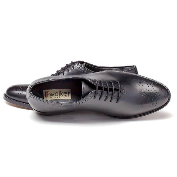 A top view of men's whole cut brogue shoes made with black leather
