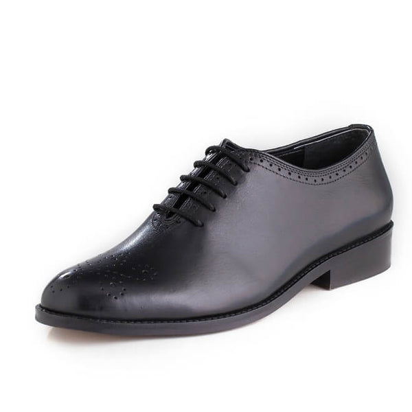 A side view of men's whole cut brogue shoes made with black leather