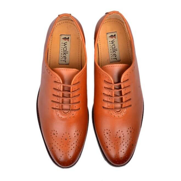 A top view of men's whole cut brogue shoes made with cognac leather