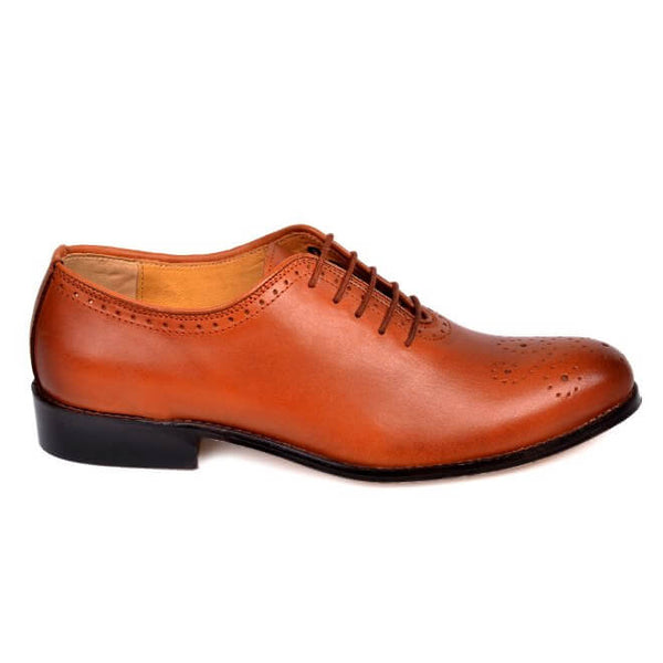 A side view of men's custom made whole cut brogue shoes made with cognac leather