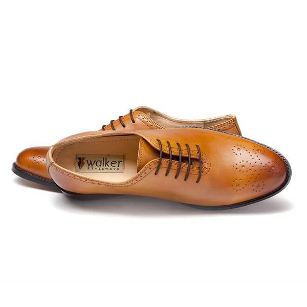 A top view of men's whole cut brogue shoes made with tan leather