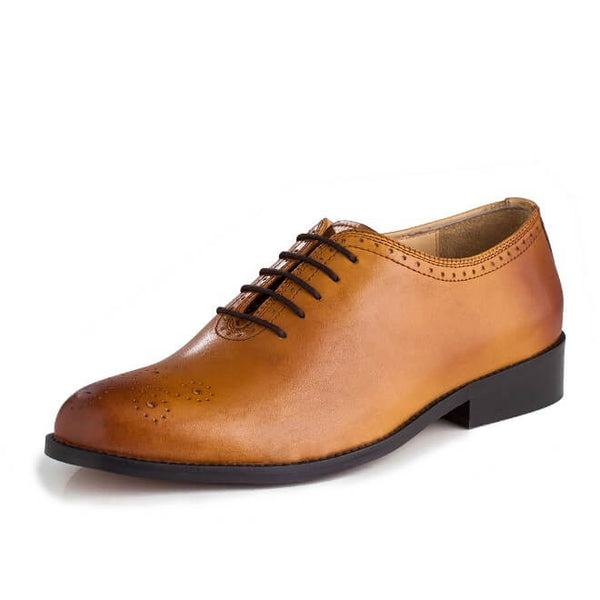 A front view of men's whole cut brogue shoes made with tan leather