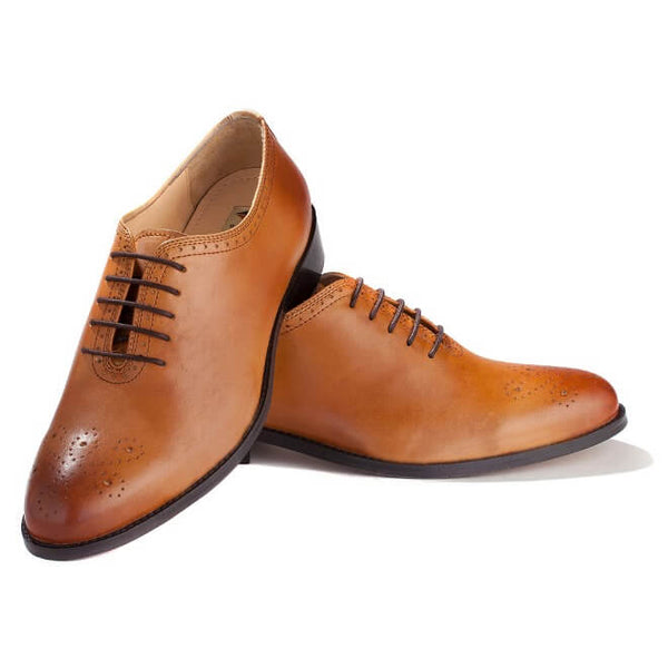 A top view of men's custom made whole cut brogue shoes made with tan leather
