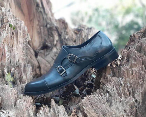 A side view of size 39 men's double monk strap shoes made with black leather