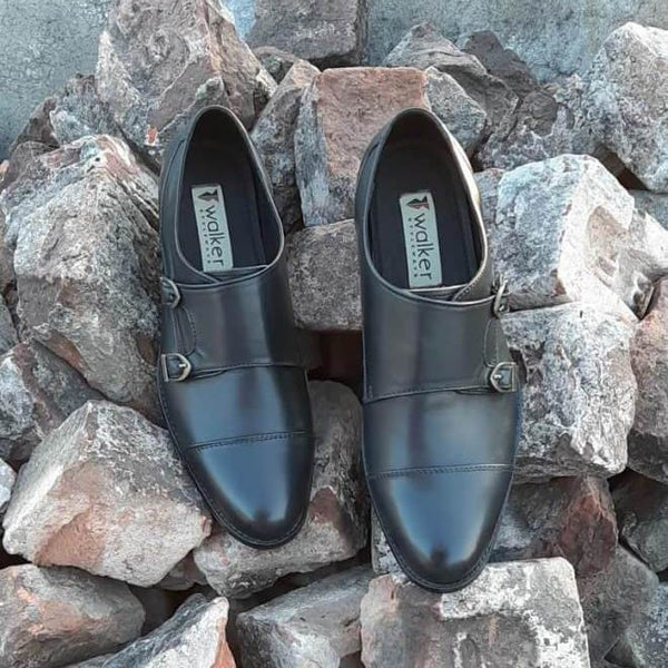 A top view of size 39 men's double monk strap shoes made with black leather