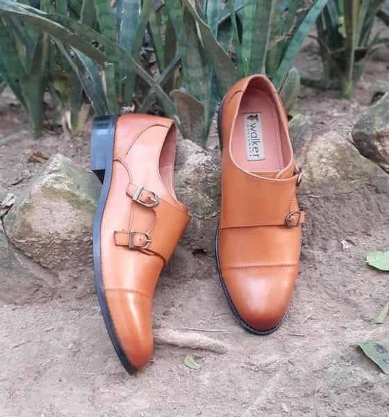 A top view of size 39 men's double monk strap shoes made with tan leather