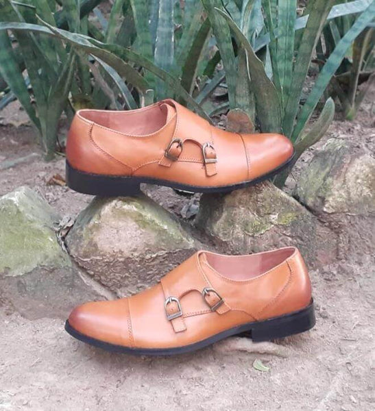 A side view of size 39 men's double monk strap shoes made with tan leather