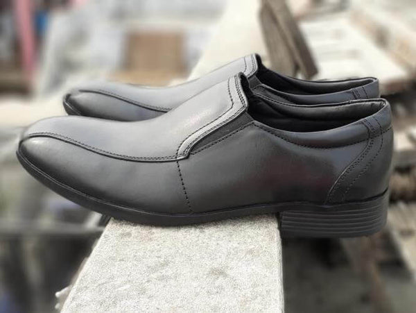 A side view of men's slipon big shoes made in black leather