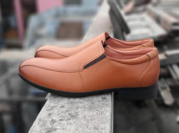 A side view of men's slipon wide shoes made in tan leather