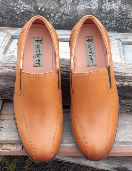 A top view of tan leather men's slip-on wide shoes showing stitching details