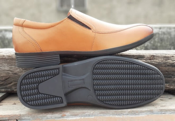 The sole side view of men's wide slip-on shoes made in tan leather