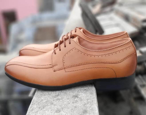 A tan leather derby men's wide shoes side view showing stitching details