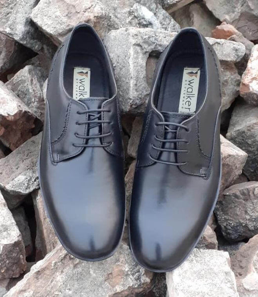 A front view of admirable black leather derby pair of big shoes