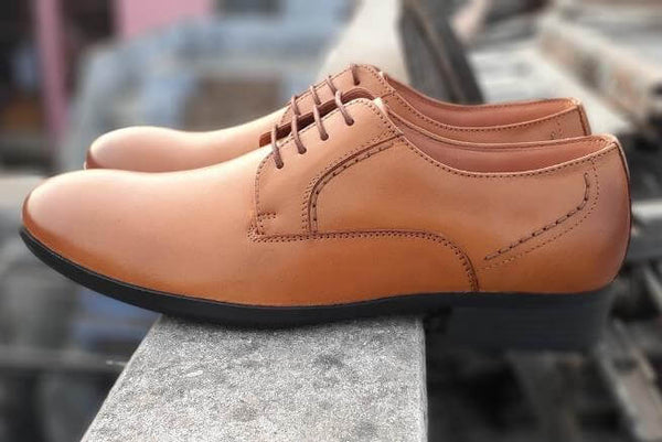 A side view of admirable tan leather derby big shoes