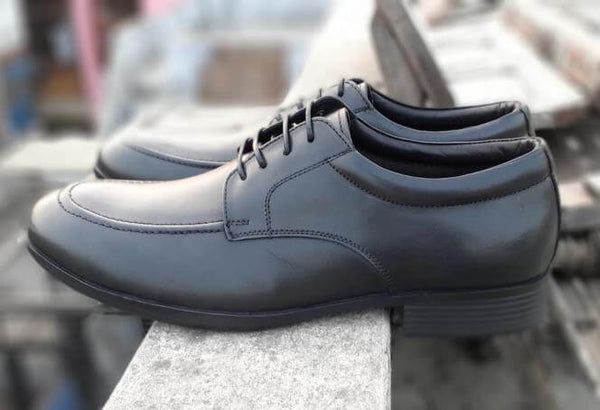 A side view of exceptional black leather derby wide shoes