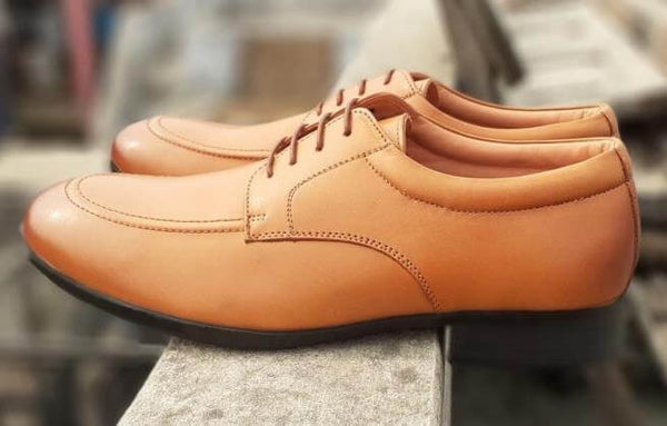 A side view of exceptional tan leather wide derby shoes
