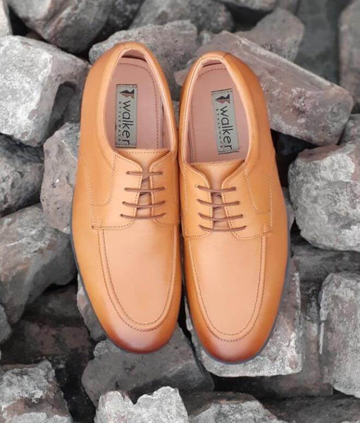 A top view of exceptional tan leather wide derby shoes