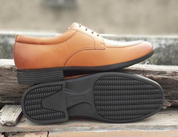 The sole side of exceptional tan leather wide derby shoes