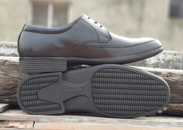The sole side of black leather men's wide shoes