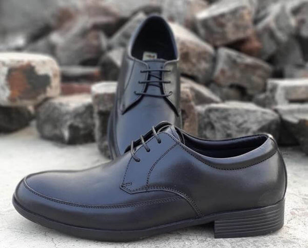 A top view and side view of black leather men's wide shoes